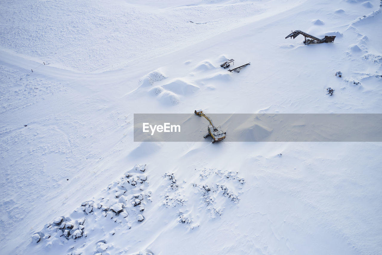 HIGH ANGLE VIEW OF PEOPLE SKIING ON SNOW LAND