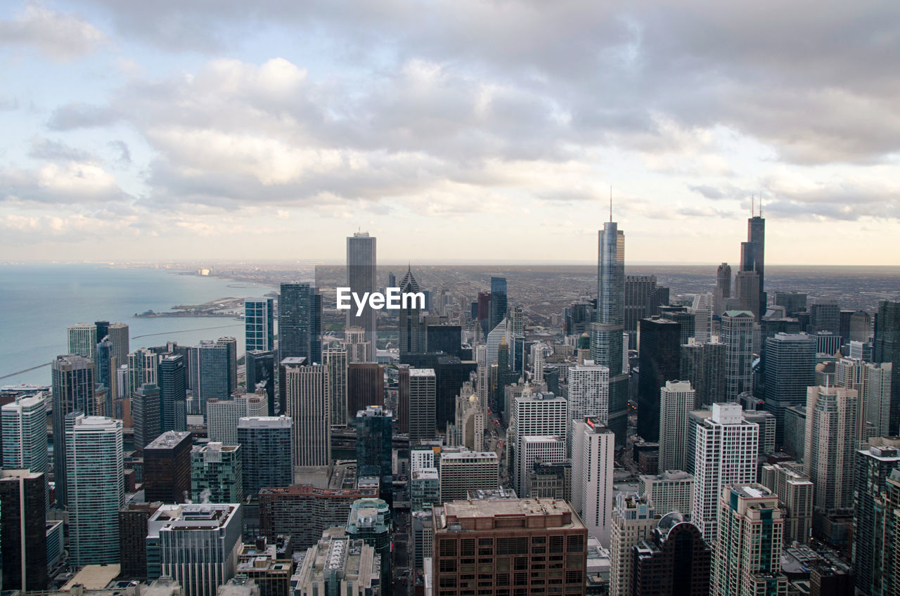 High Angle View Of Chicago Against Cloudy Sky