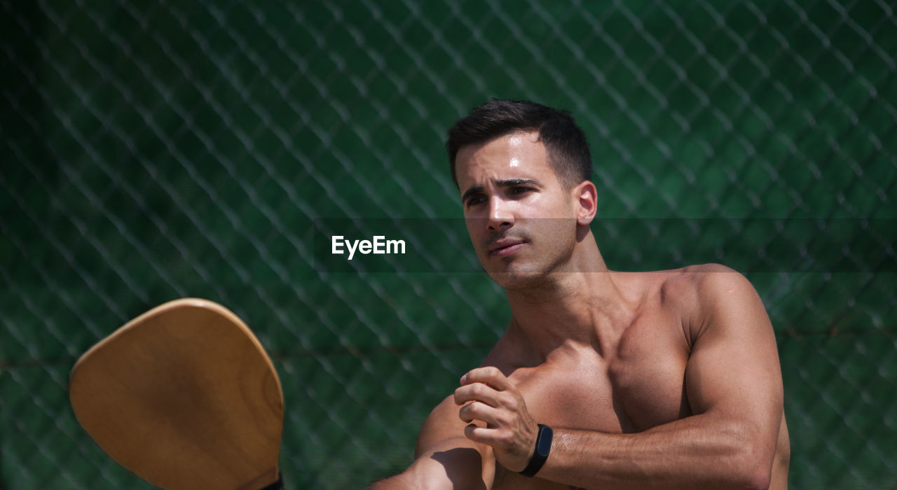 Shirtless Young Man With Sports Equipment