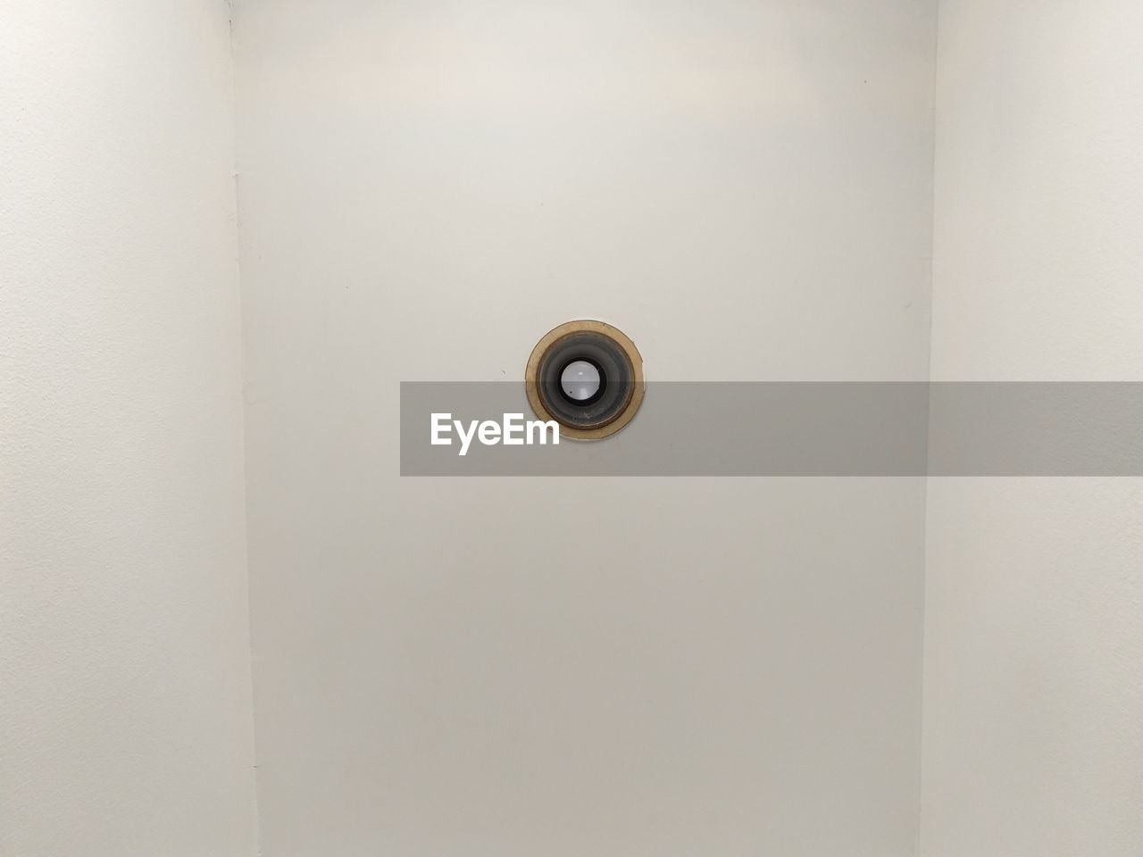 indoors, white color, door, ceiling, geometric shape, no people, entrance, circle, security, shape, technology, electricity, wall - building feature, close-up, safety, copy space, protection, keyhole, backgrounds, lock, directly below
