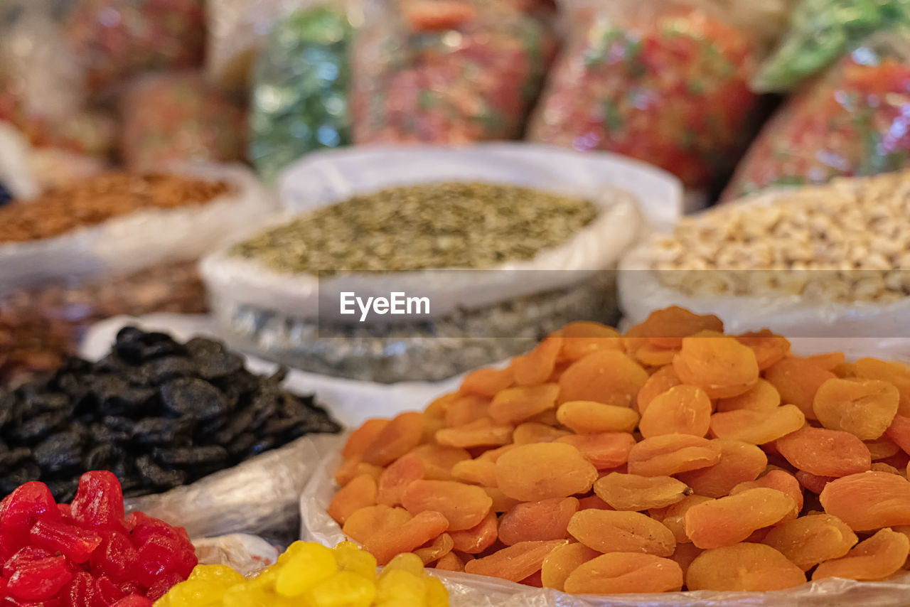 food, food and drink, choice, freshness, variation, healthy eating, for sale, market, wellbeing, large group of objects, still life, retail, close-up, market stall, no people, dried food, spice, indoors, focus on foreground, ingredient, retail display, cardamom