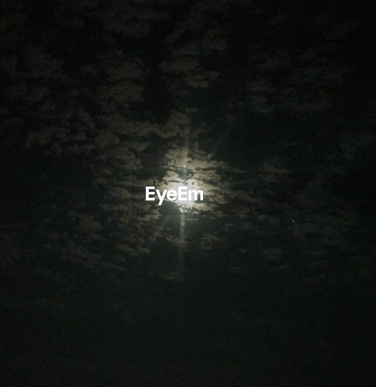 sky, night, moon, low angle view, full moon, moonlight, beauty in nature, no people, cloud - sky, nature, tranquility, astronomy, scenics - nature, dark, glowing, outdoors, space, tranquil scene, illuminated, planetary moon, eclipse
