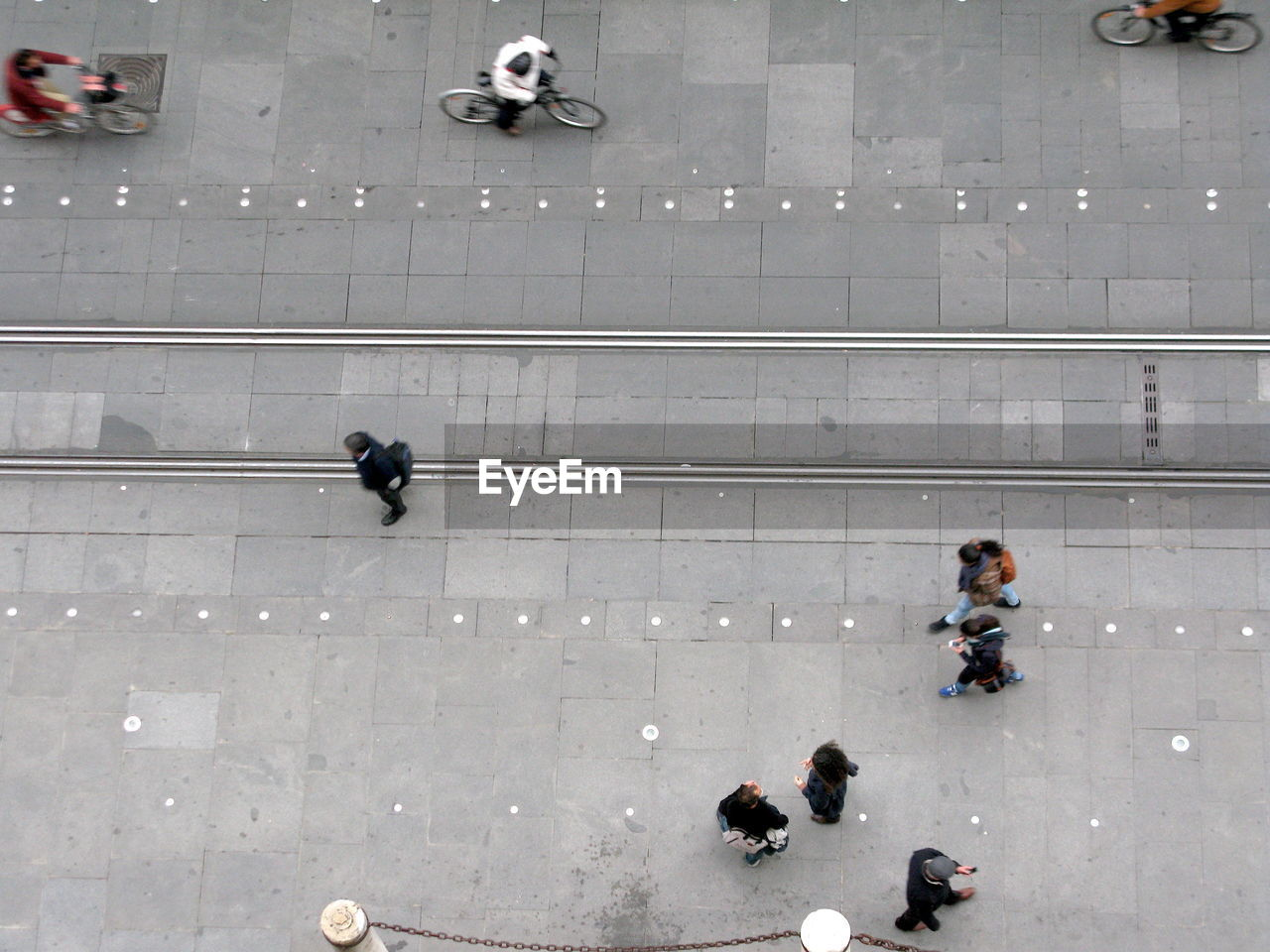 Directly Above Shot Of People By Tramway On Street