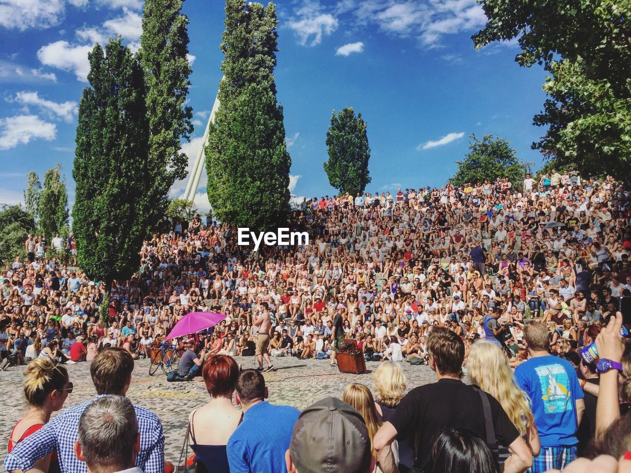 Crowd In Park Against Sky
