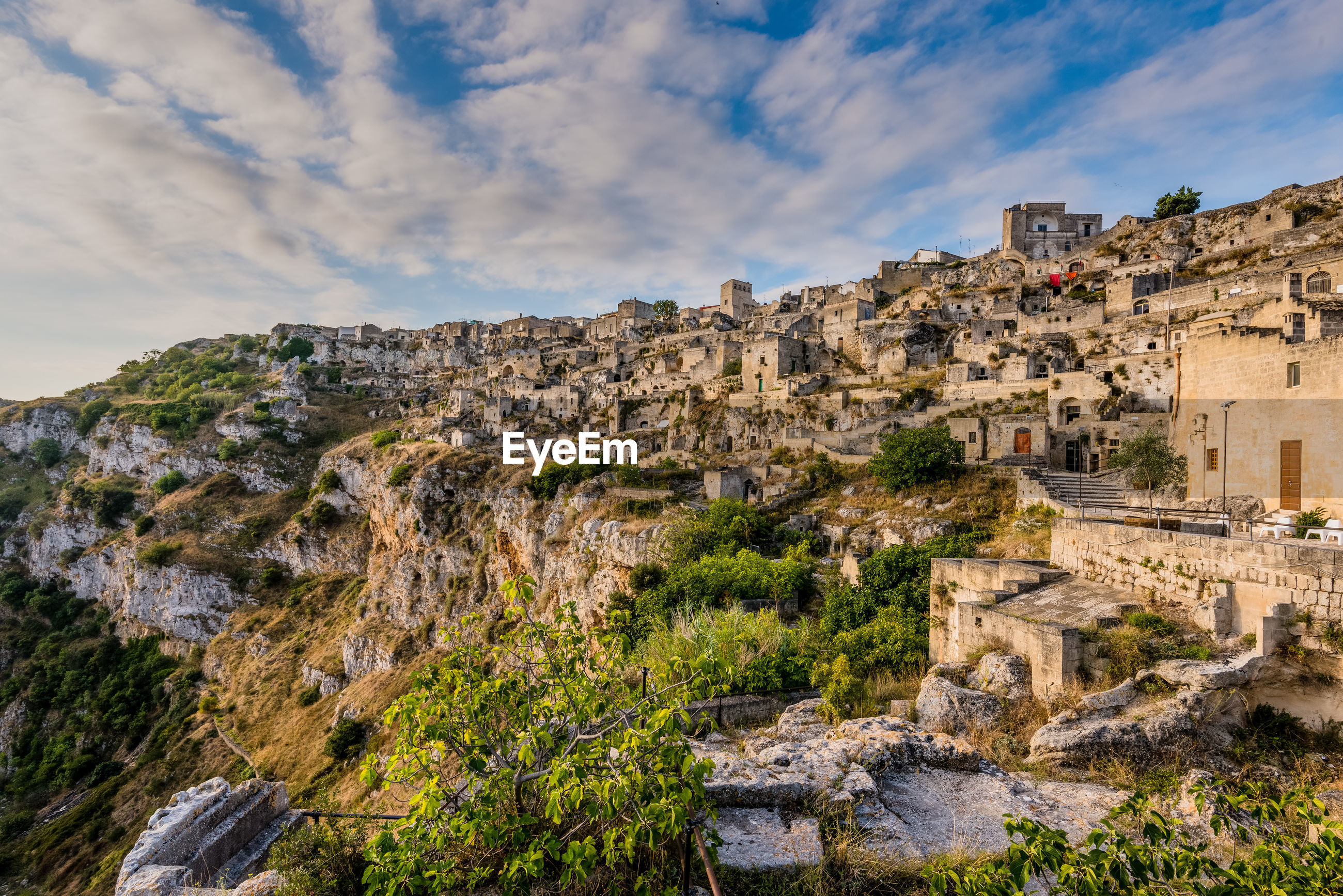 Houses on mountain at sassi di matera against blue sky