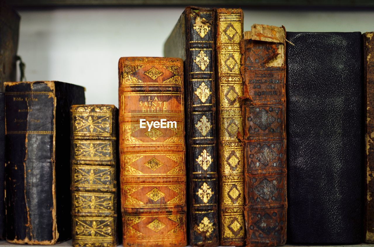 book, learning, education, hardcover book, literature, book cover, library, indoors, wisdom, bookshelf, antique, no people, bookstore, close-up, old-fashioned, day