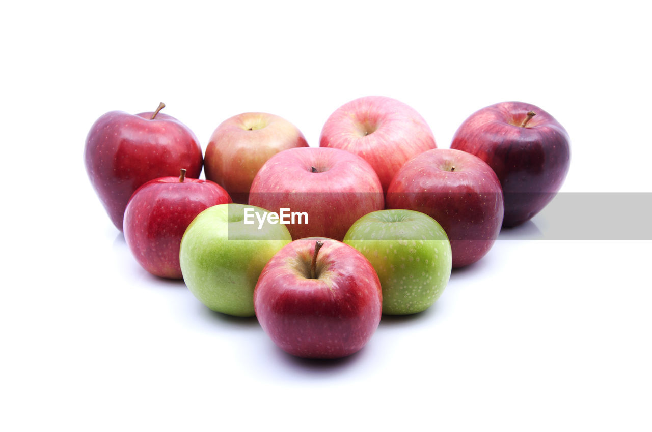 Close-Up Of Fresh Apples Over White Background