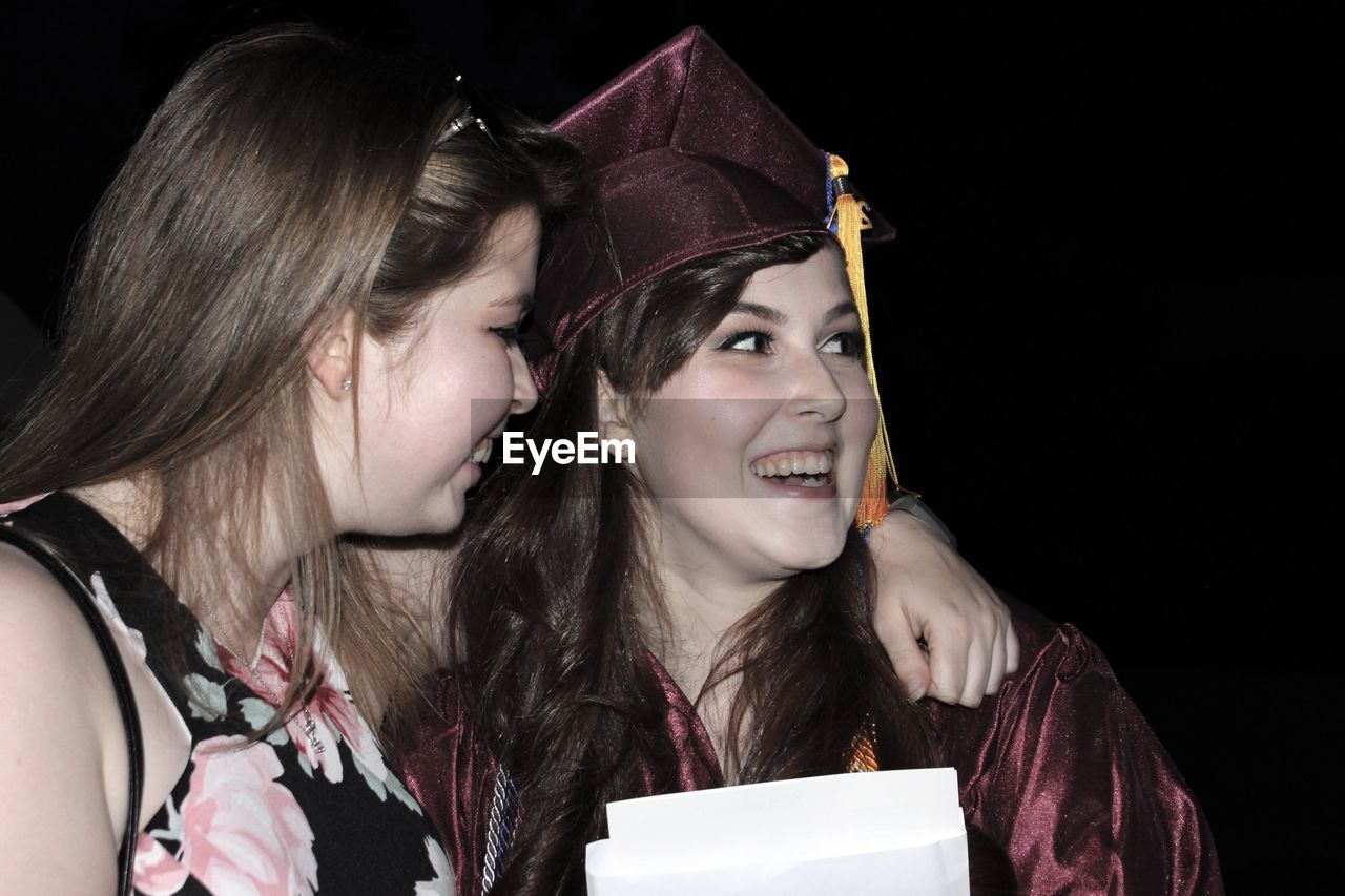 Portrait Of Woman Wearing Graduation Gown
