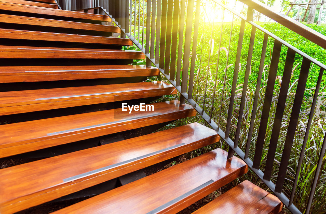 no people, day, plant, nature, growth, land, architecture, outdoors, wood - material, green color, grass, sunlight, field, in a row, staircase, railing, close-up, built structure, empty, tree