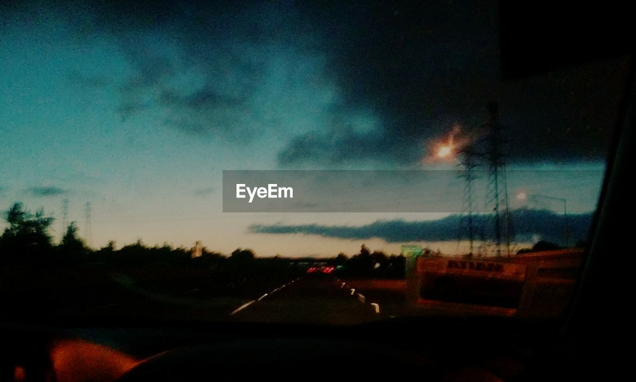 car, vehicle interior, car interior, transportation, land vehicle, windshield, mode of transport, glass - material, car point of view, road, journey, travel, driving, no people, road trip, sky, dashboard, steering wheel, vehicle mirror, nature, sunset, day, tree, outdoors, close-up