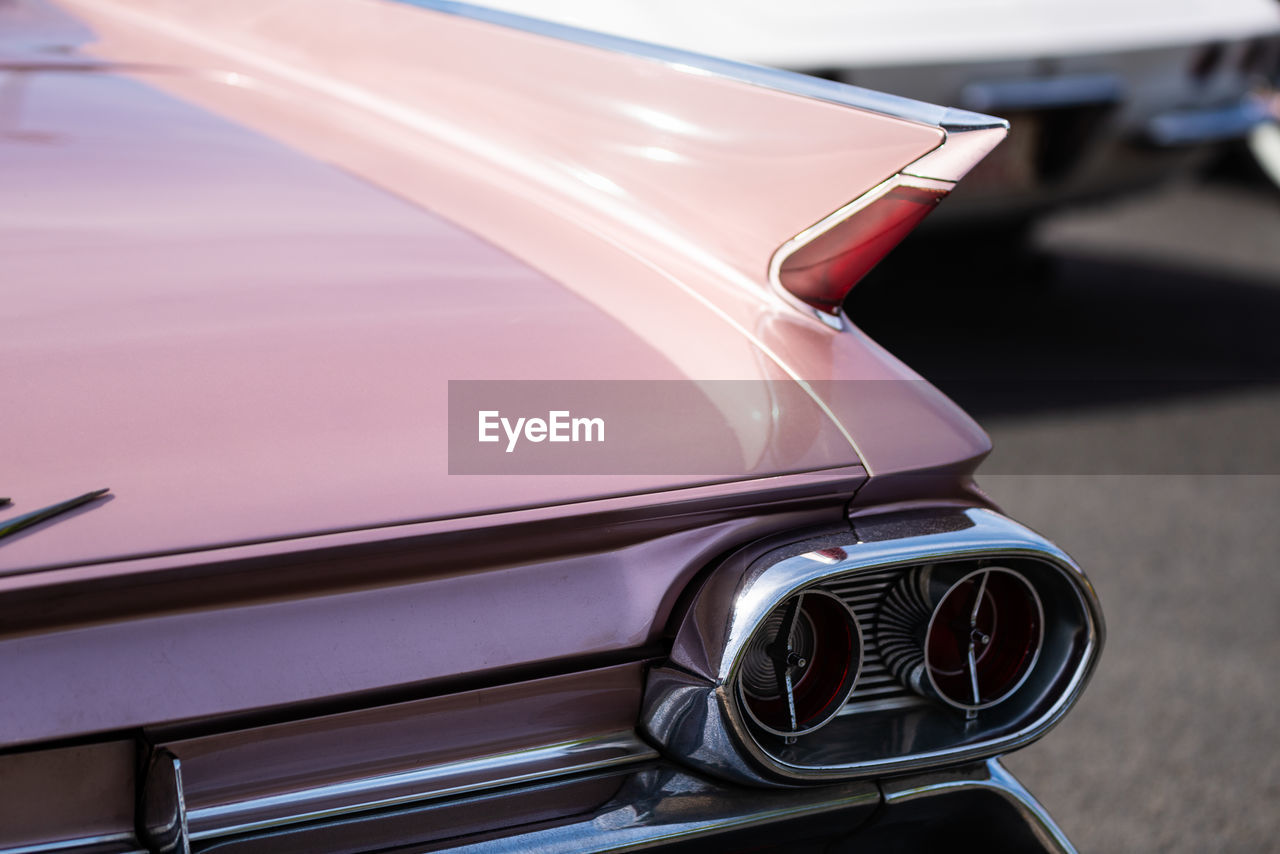 car, motor vehicle, land vehicle, mode of transportation, transportation, vintage car, retro styled, no people, day, focus on foreground, travel, close-up, vehicle interior, headlight, outdoors, stationary, glass - material, vehicle hood, car interior, luxury, silver colored, chrome