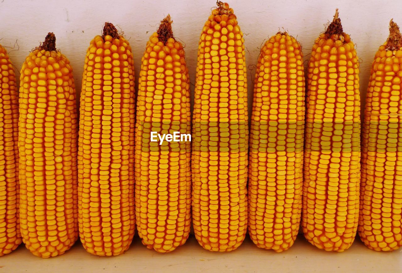 Close-Up Of Sweetcorns Arranged Side By Side