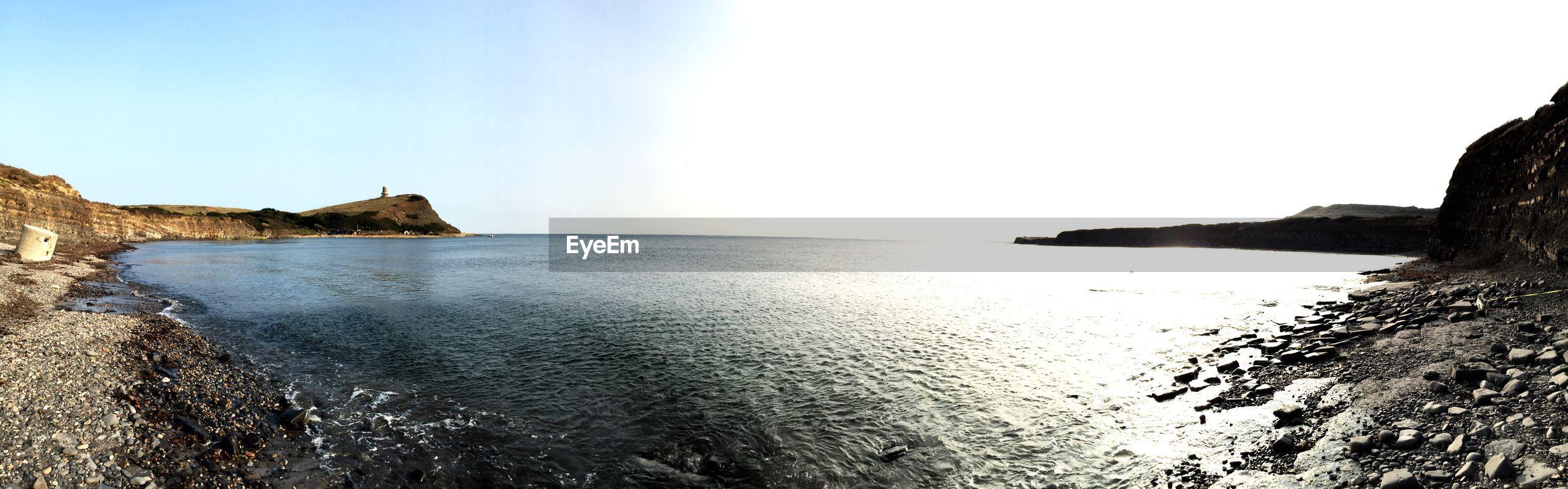 Panoramic view of kimmeridge bay against sky