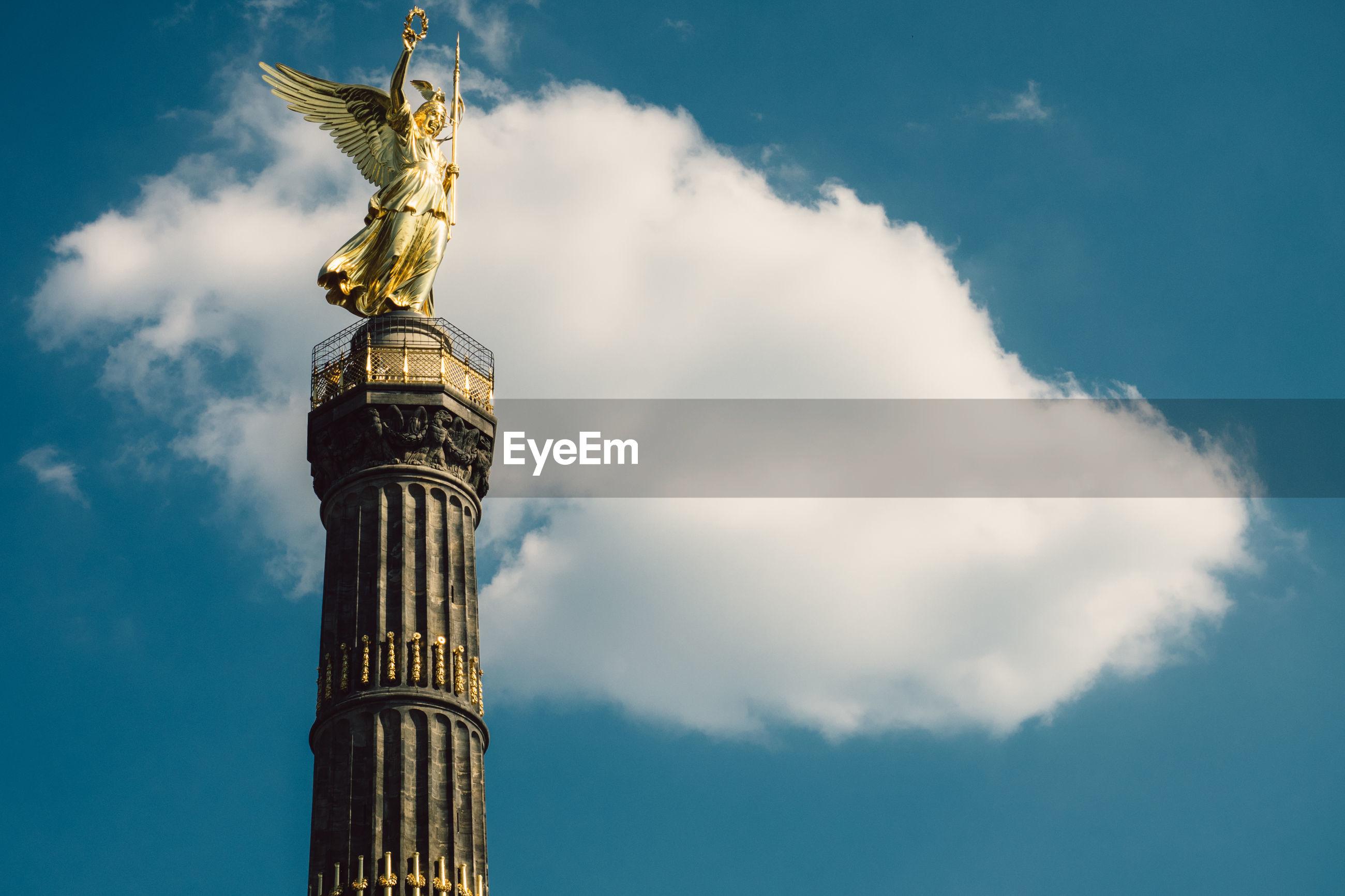 Low angle view of berlin victory column against sky