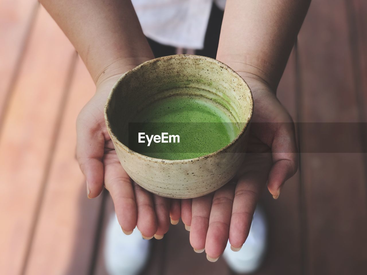 Close-Up Of Human Hand Holding Tea