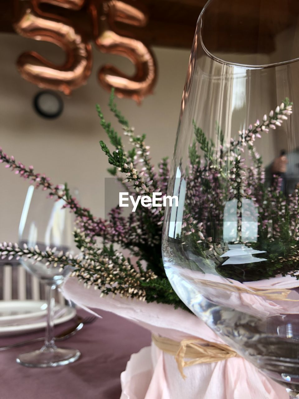 indoors, glass - material, glass, table, transparent, still life, no people, wineglass, focus on foreground, selective focus, close-up, household equipment, celebration, decoration, choice, food and drink, container, drinking glass, variation, large group of objects, luxury, silver colored, setting