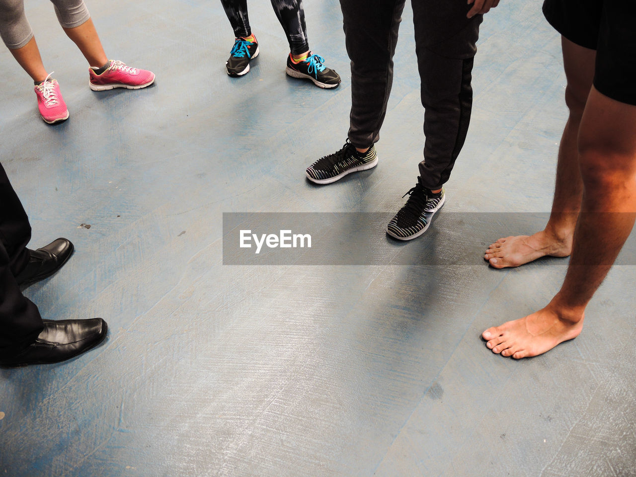 Low Section Of People Standing On Floor