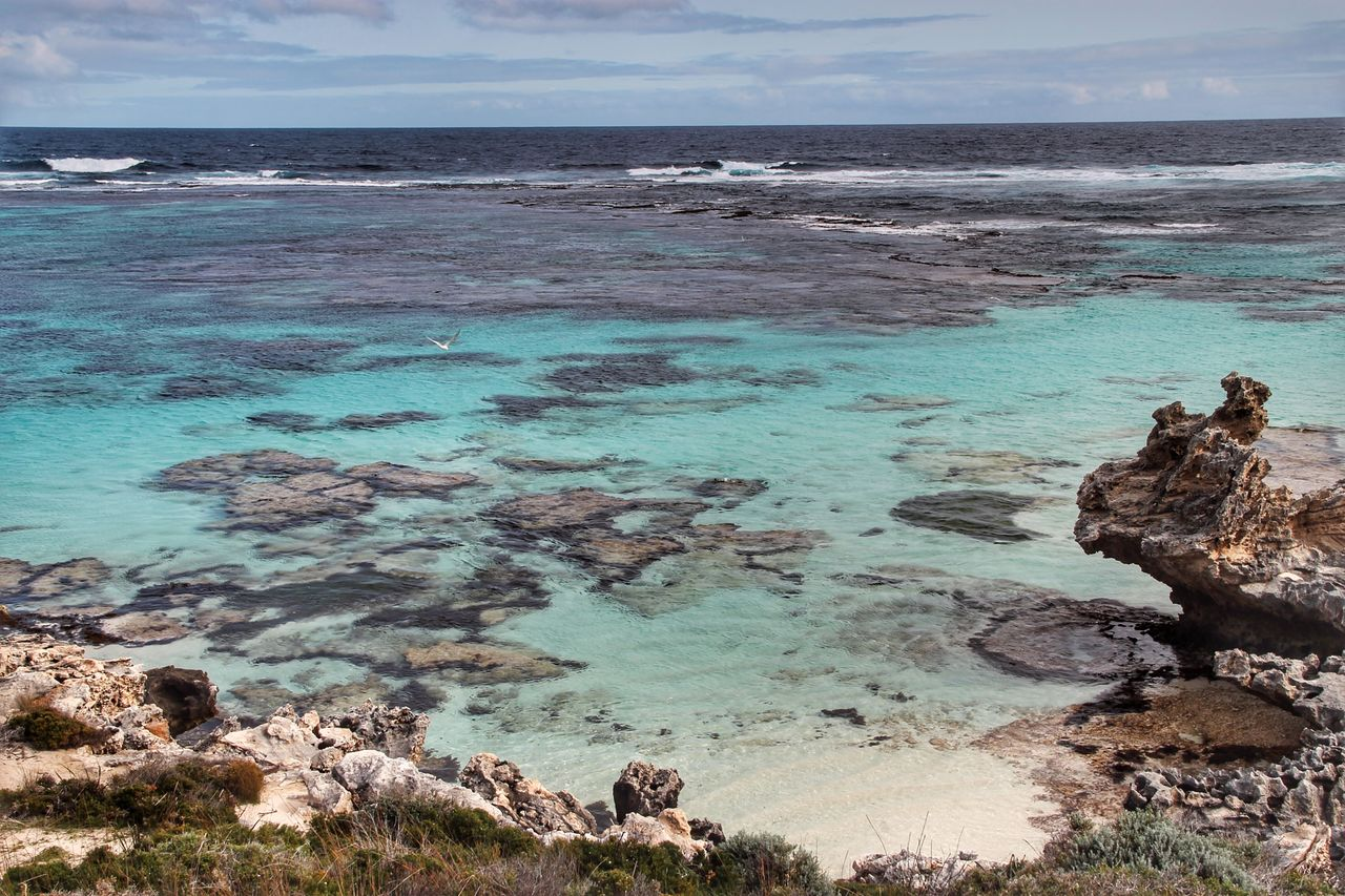 water, sea, beauty in nature, scenics - nature, sky, land, rock, tranquil scene, beach, tranquility, horizon, rock - object, solid, nature, day, horizon over water, no people, cloud - sky, idyllic, outdoors, turquoise colored, rocky coastline