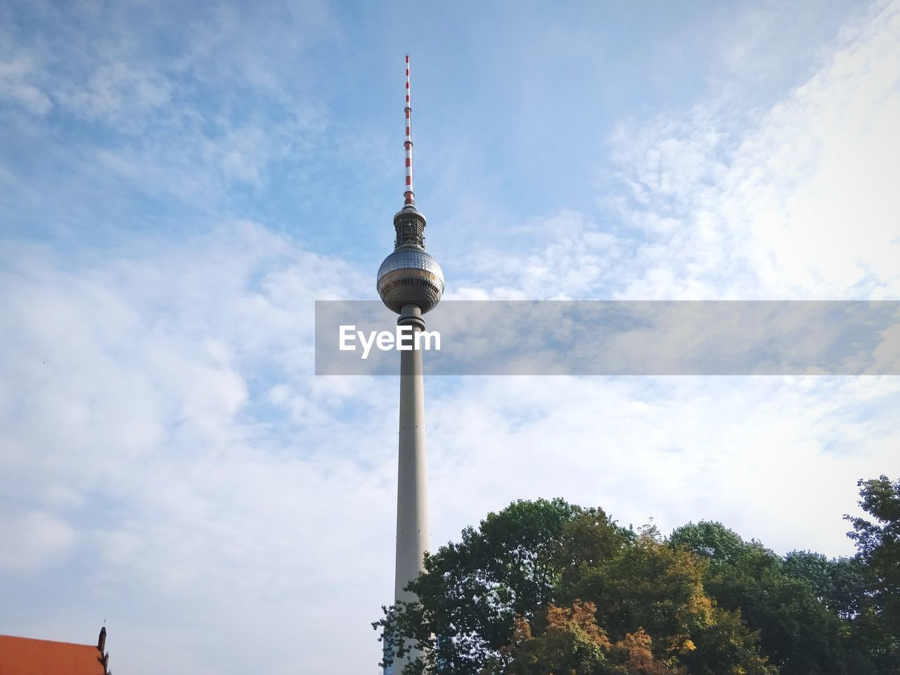 Low Angle View Of Fernsehturm Against Cloud Sky