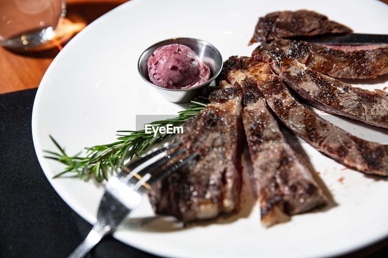 food, food and drink, plate, freshness, ready-to-eat, indoors, meat, still life, table, close-up, serving size, red meat, no people, meal, rosemary, high angle view, healthy eating, wellbeing, vegetable, eating utensil, beef, garnish, crockery, temptation