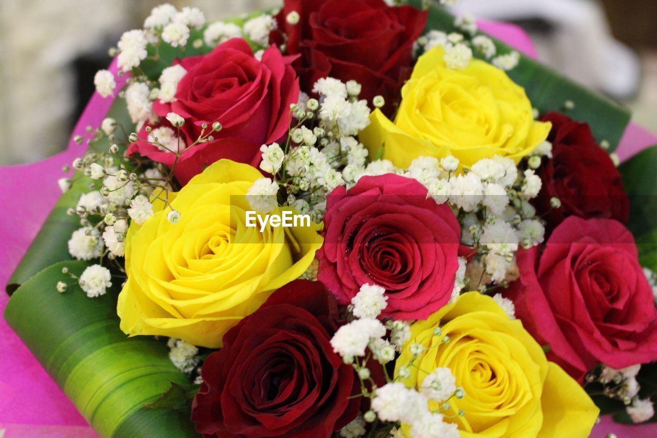 flower, bouquet, rose - flower, variation, freshness, fragility, celebration, multi colored, high angle view, petal, close-up, flower head, large group of objects, no people, life events, beauty in nature, flower market, nature, indoors, day, florist