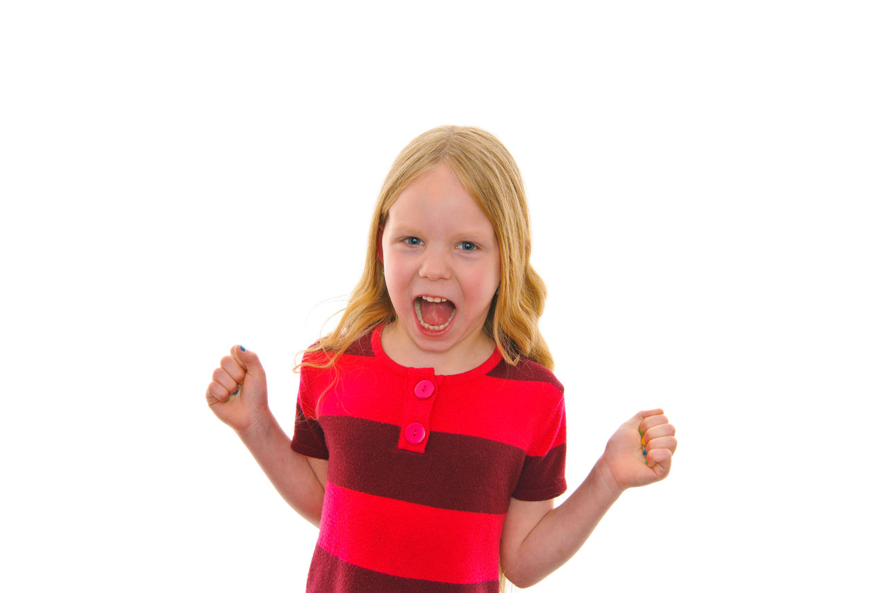 childhood, white background, child, studio shot, blond hair, front view, girls, emotion, mouth, one person, mouth open, portrait, looking at camera, indoors, copy space, waist up, hair, casual clothing, innocence, hairstyle, pre-adolescent child, making a face, excitement