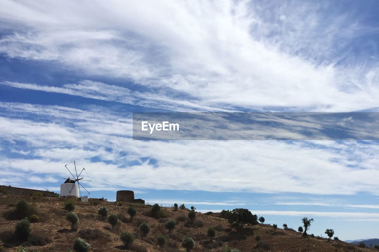sky, cloud - sky, environment, nature, renewable energy, alternative energy, day, scenics - nature, environmental conservation, beauty in nature, wind turbine, turbine, fuel and power generation, land, wind power, landscape, hill, no people, low angle view, tranquility, outdoors