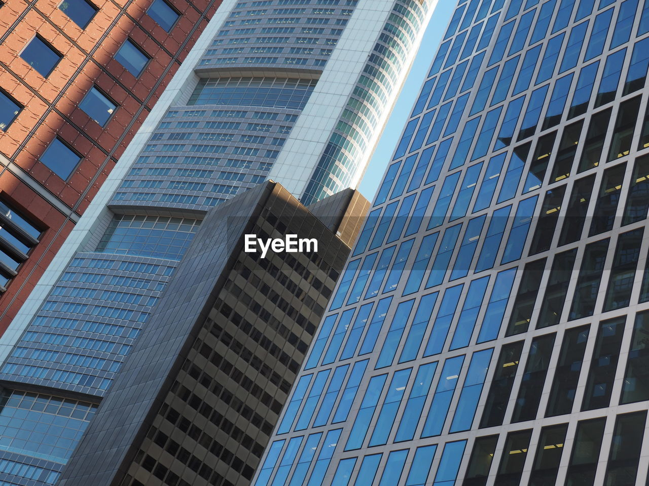 architecture, skyscraper, modern, building exterior, office building exterior, built structure, low angle view, window, business, office, day, city, outdoors, no people, office park