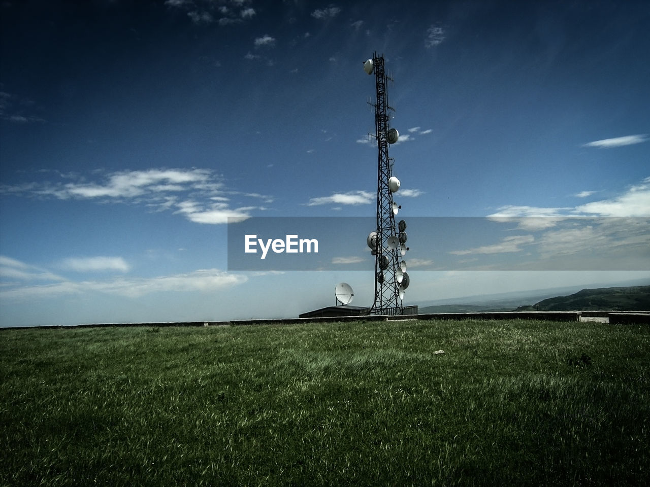 field, sky, technology, grass, outdoors, no people, cloud - sky, nature, day, blue, beauty in nature