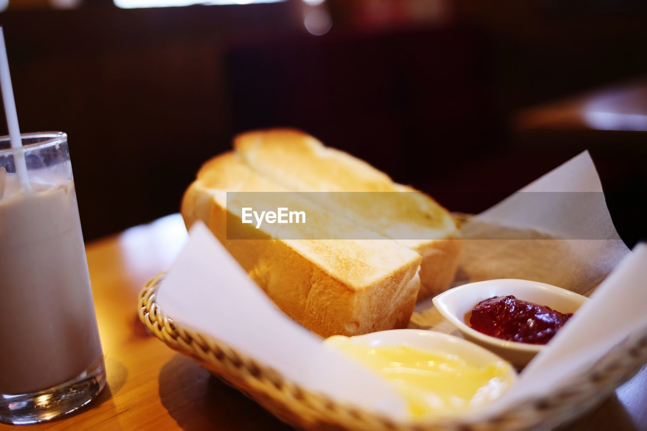 food and drink, food, freshness, drink, table, glass, indoors, dairy product, still life, ready-to-eat, plate, close-up, drinking glass, selective focus, refreshment, household equipment, bread, no people, wellbeing, serving size, temptation, snack, breakfast