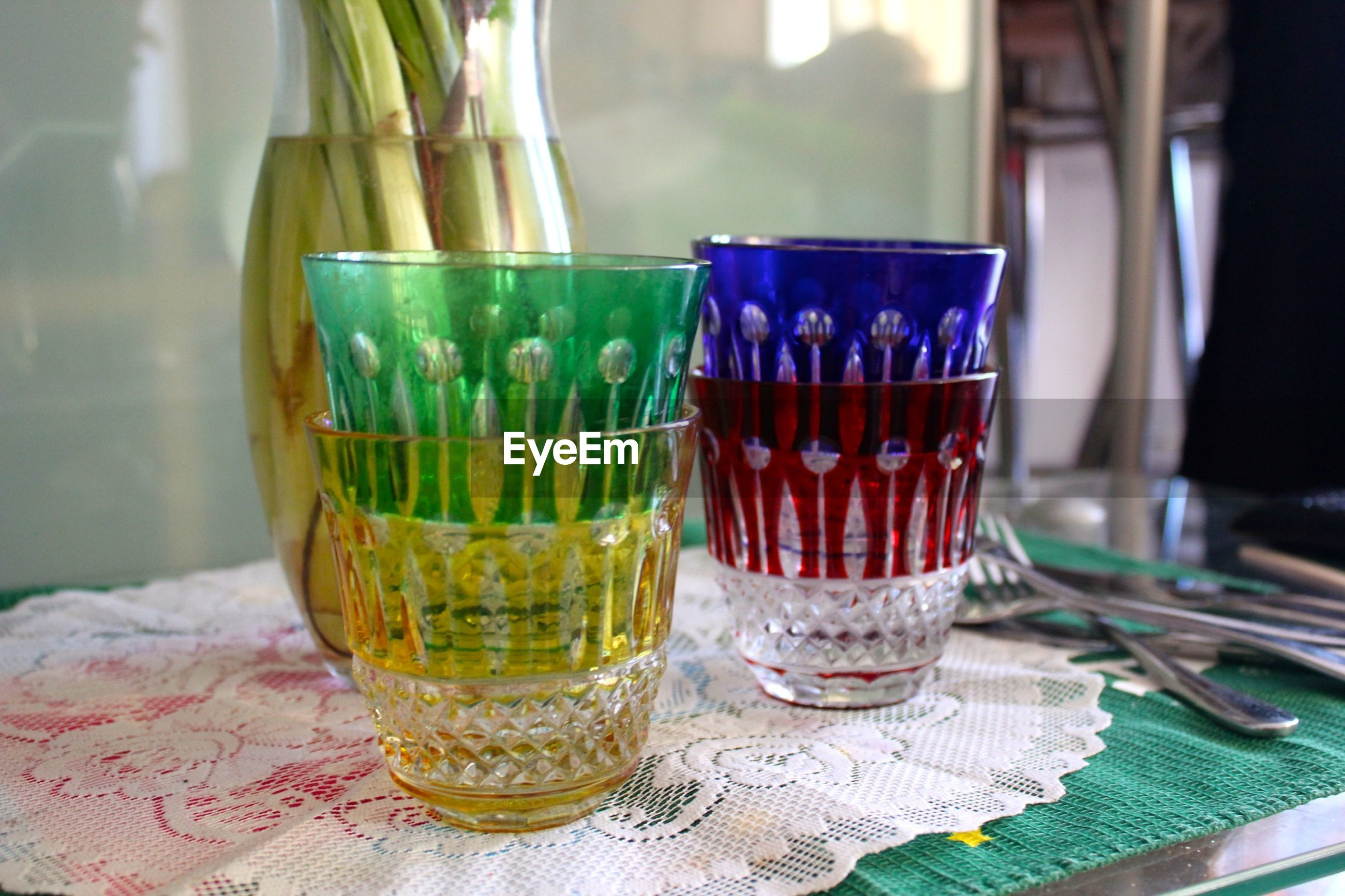Close-up of multi colored drinking glass on table