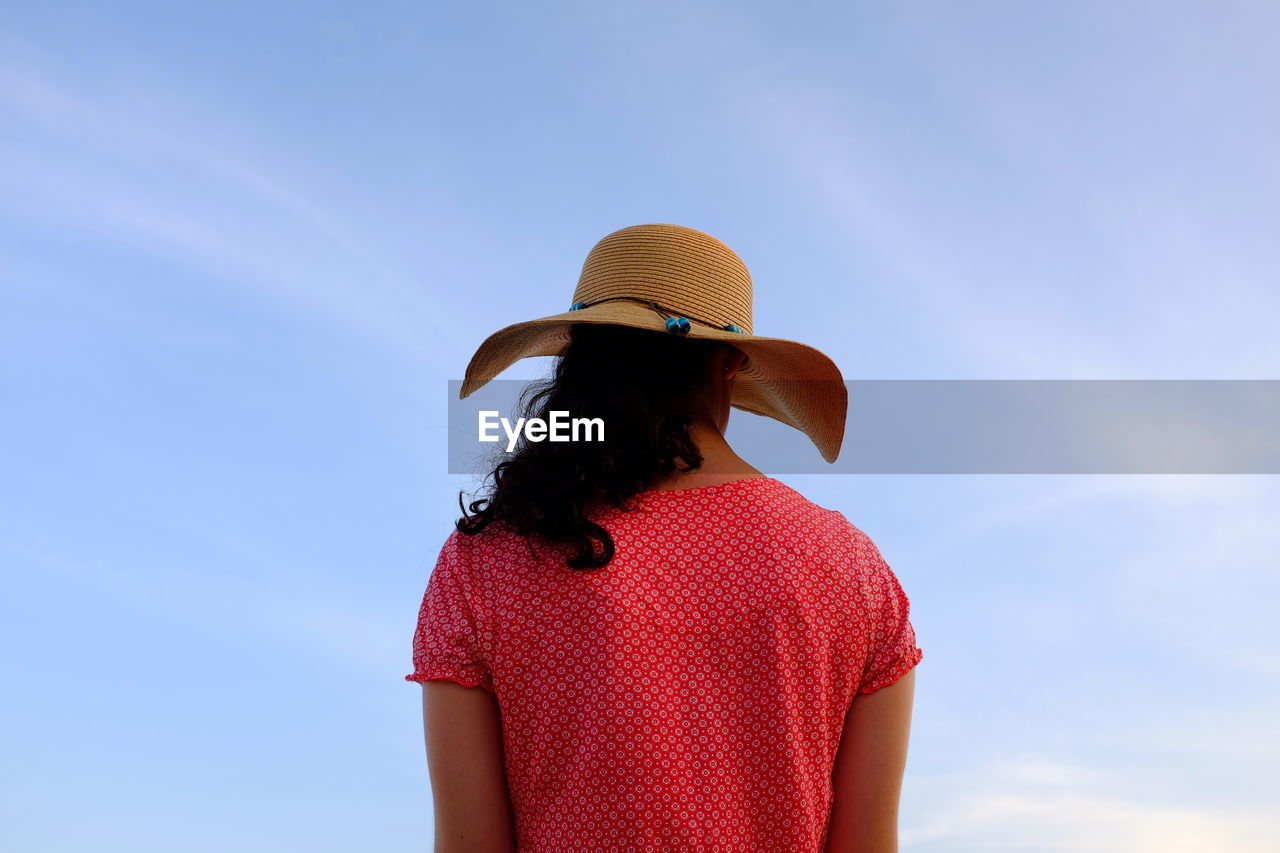 Rear View Of Woman Wearing Hat Against Sky
