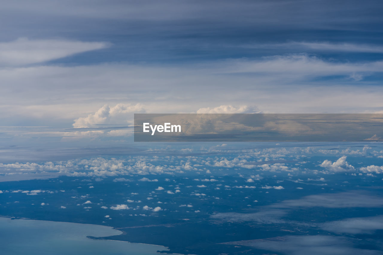 cloud - sky, sky, beauty in nature, scenics - nature, tranquility, tranquil scene, nature, no people, environment, aerial view, idyllic, outdoors, day, cloudscape, landscape, non-urban scene, blue, ethereal, distant, meteorology, above