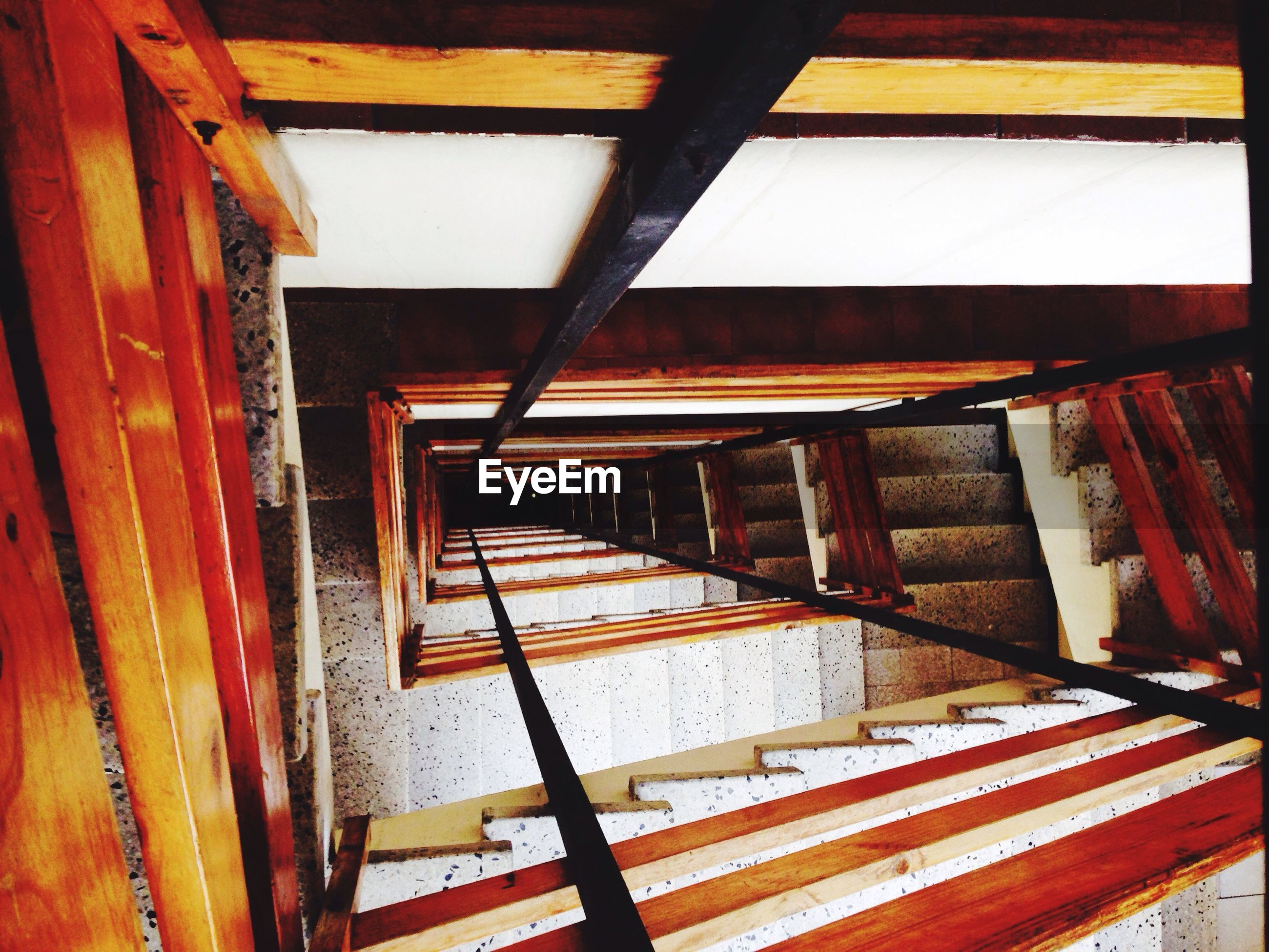 indoors, built structure, architecture, wood - material, red, house, steps, wooden, no people, day, window, wood, railing, wall - building feature, orange color, building exterior, high angle view, sunlight, close-up, old
