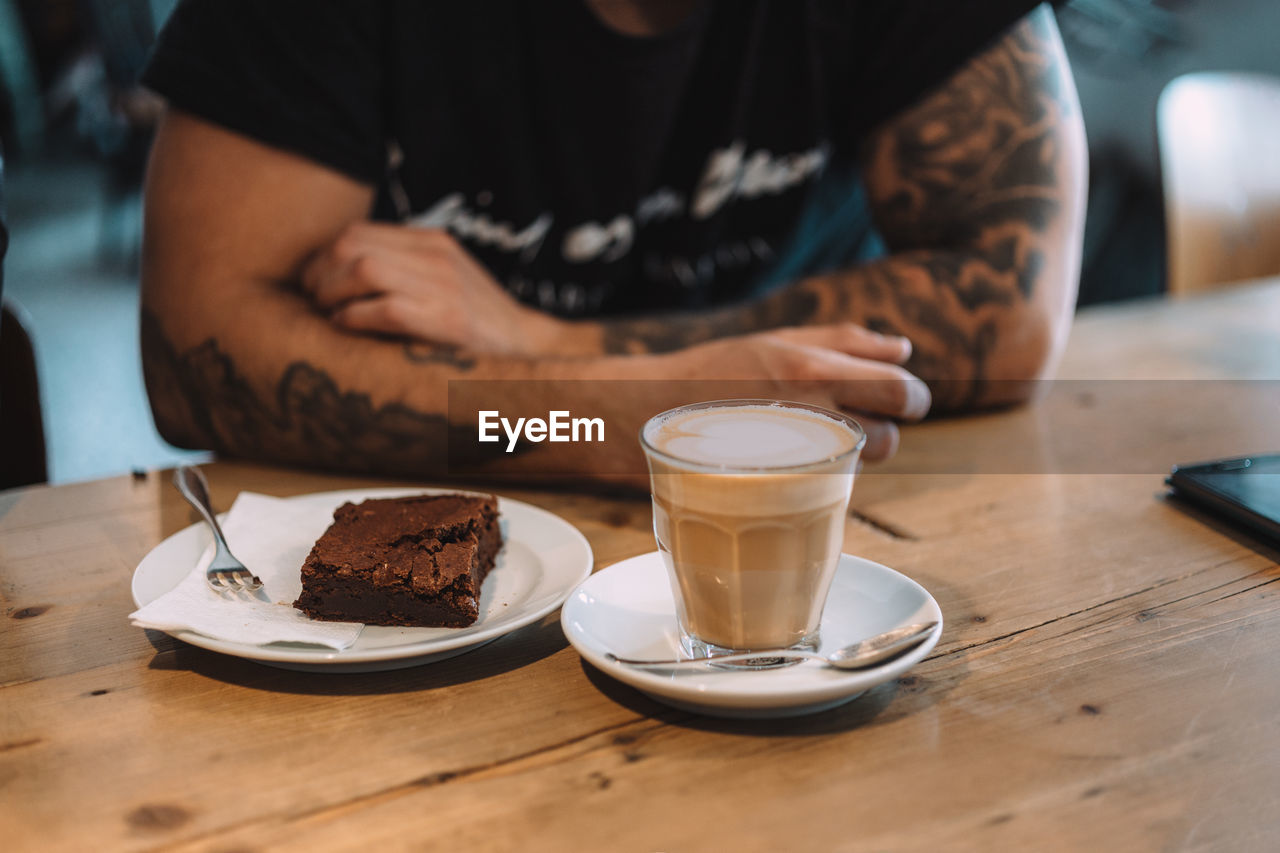 Midsection Of A Man Enjoying Coffee