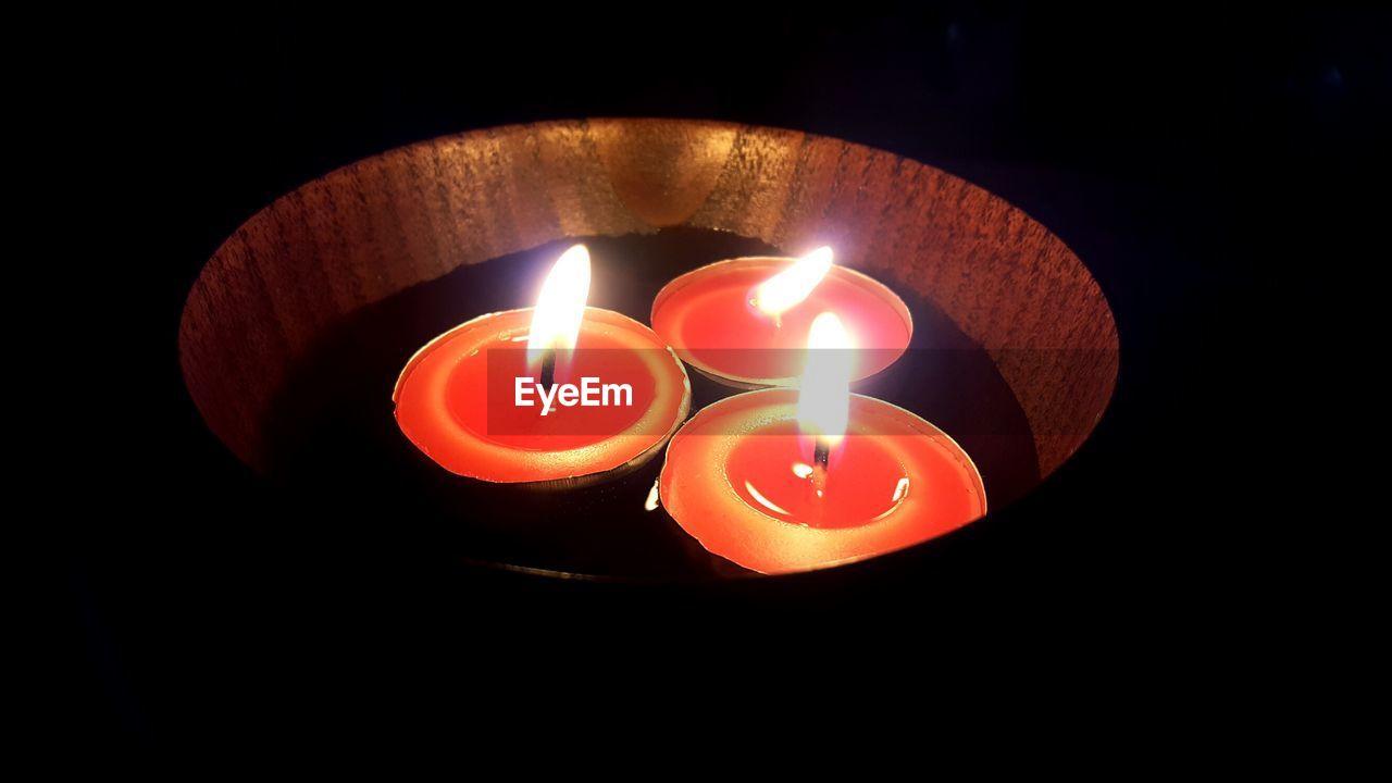 flame, candle, heat - temperature, burning, illuminated, no people, darkroom, close-up, indoors, night, black background, diya - oil lamp