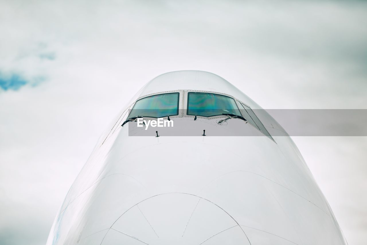 Close-Up Of Airplane Against Sky