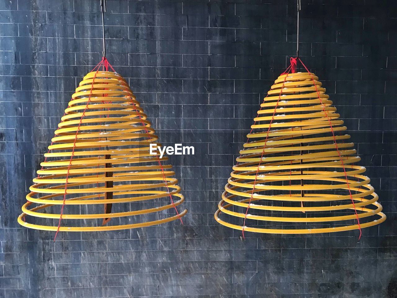 no people, yellow, hanging, in a row, side by side, close-up, cone, indoors, architecture, art and craft, pattern, lighting equipment, built structure, celebration, craft, freshness, wall - building feature