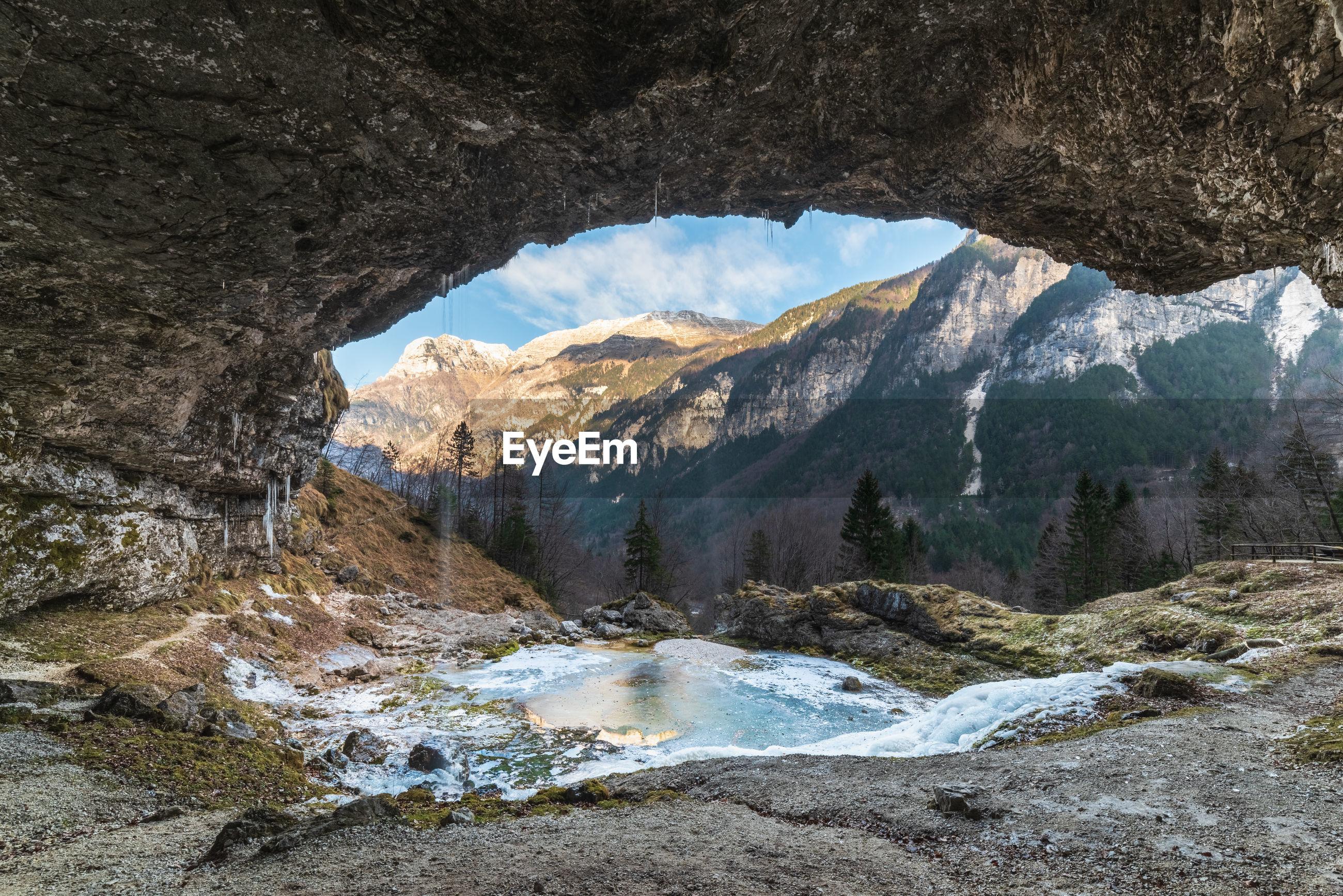 Winter. ice games in the fontanon of goriuda waterfall. friuli, italy.