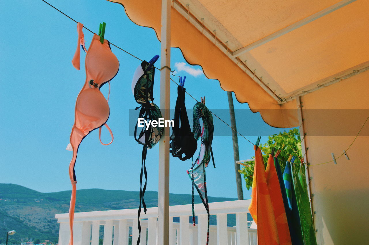 LOW ANGLE VIEW OF CLOTHES HANGING ON CLOTHESLINE