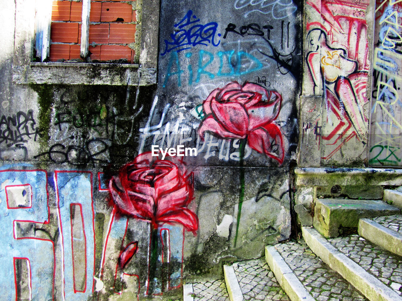 graffiti, architecture, multi colored, street art, built structure, no people, day, red, building exterior, outdoors, close-up