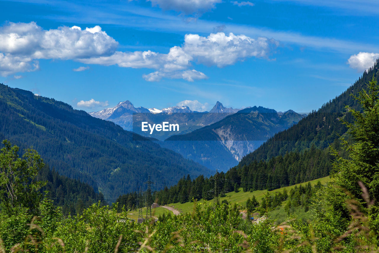 mountain, nature, sky, beauty in nature, scenics, landscape, mountain range, tranquility, forest, day, no people, tree, outdoors