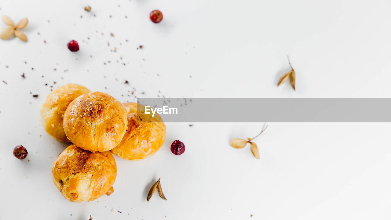 food and drink, food, indoors, freshness, fruit, still life, sweet food, high angle view, no people, close-up, ready-to-eat, plate, studio shot, indulgence, dessert, sweet, directly above, healthy eating, white background, table, temptation
