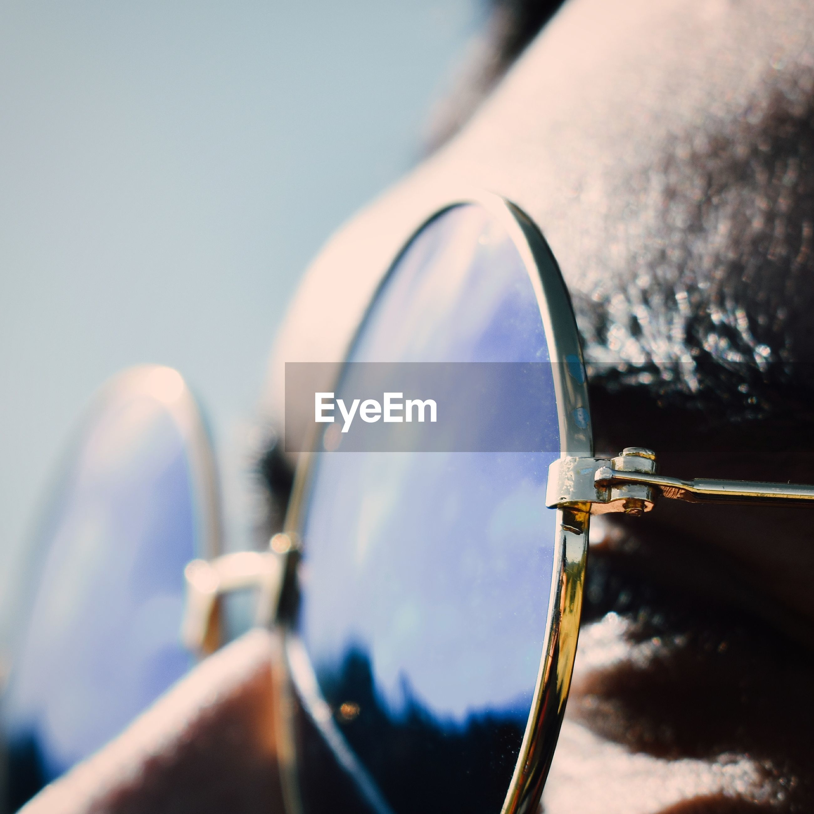 Close-up of person wearing eyeglasses