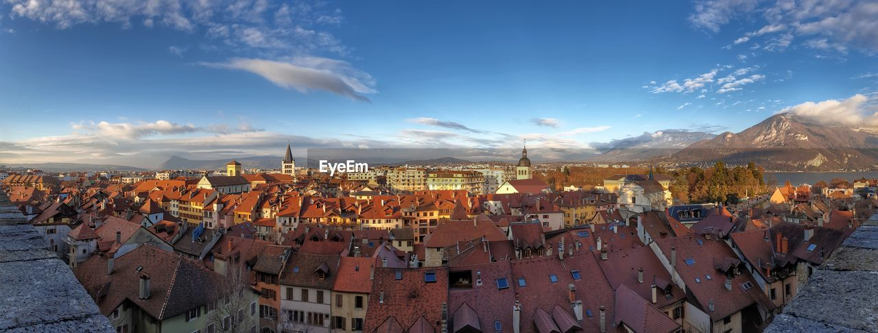 cloud - sky, sky, architecture, built structure, mountain, building exterior, nature, residential district, building, crowd, city, scenics - nature, town, roof, panoramic, day, crowded, beauty in nature, outdoors, high angle view, cityscape, townscape