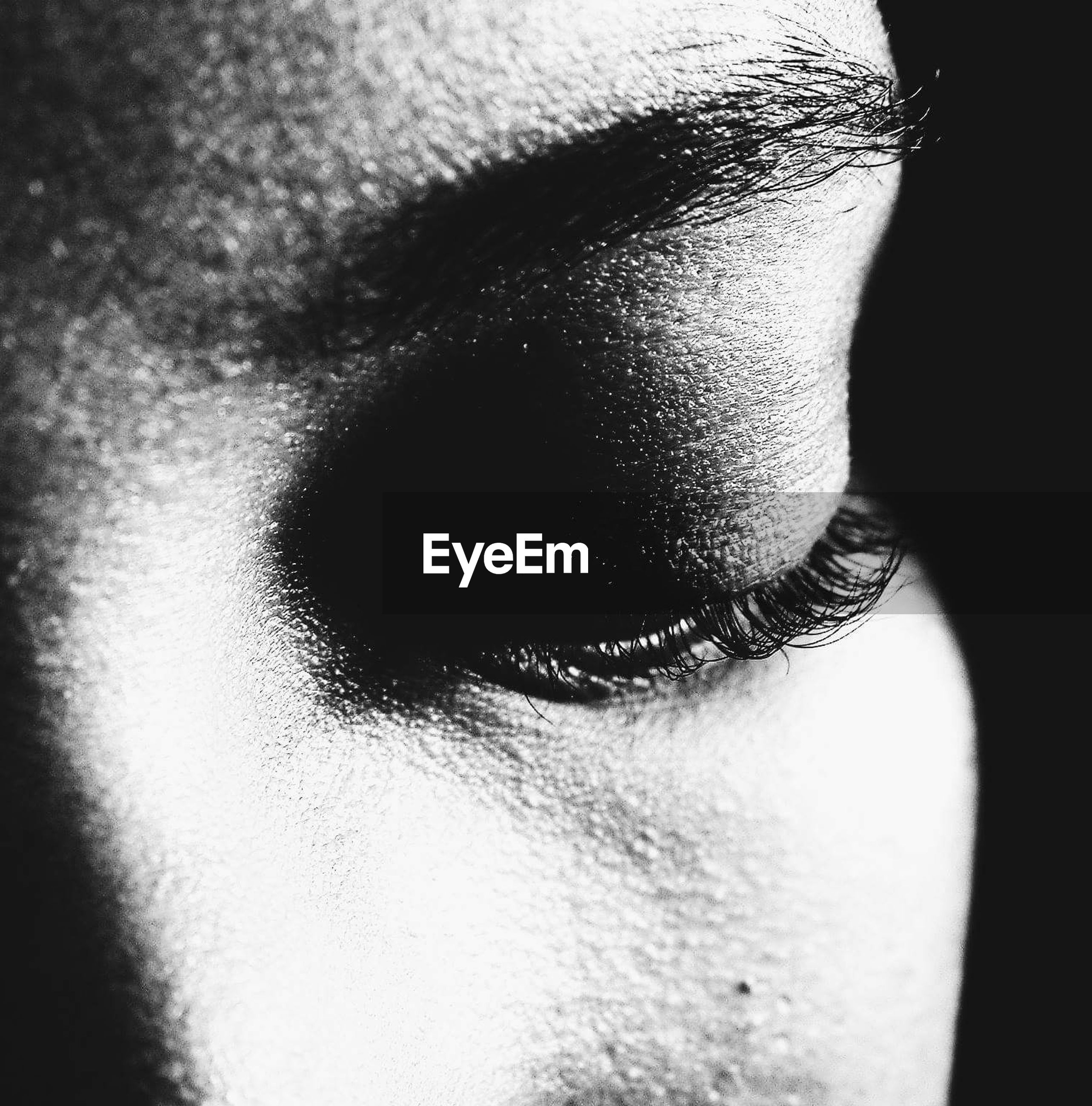 Close-up of woman eye looking down