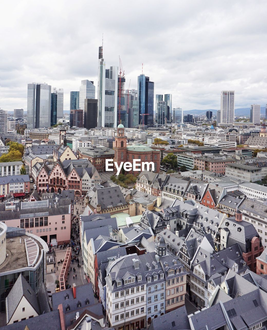 built structure, architecture, building exterior, city, cityscape, building, sky, cloud - sky, residential district, travel destinations, day, tower, crowd, nature, office building exterior, skyscraper, crowded, high angle view, urban skyline, tall - high, outdoors, modern, financial district, spire