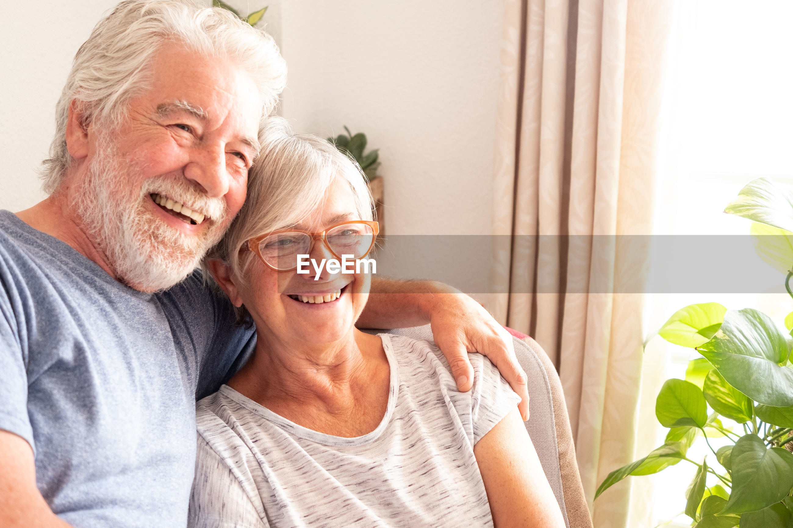 Smiling senior couple spending leisure time at home