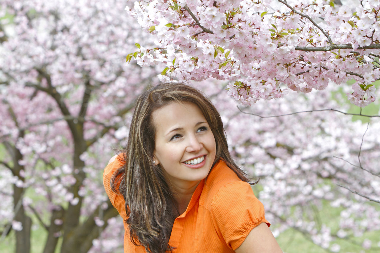 Smiling Woman Against Tree
