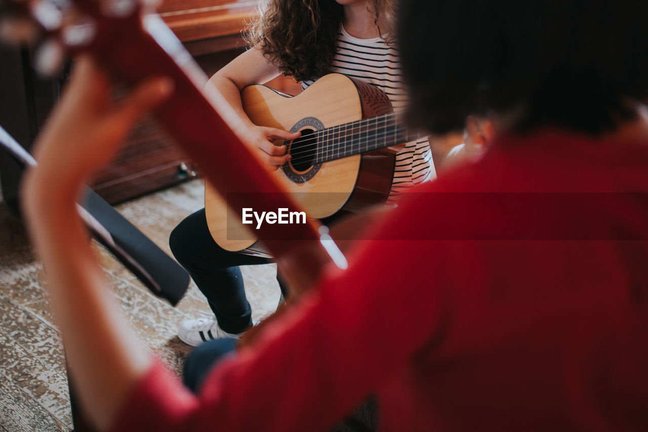 Women Playing Guitar In Music School